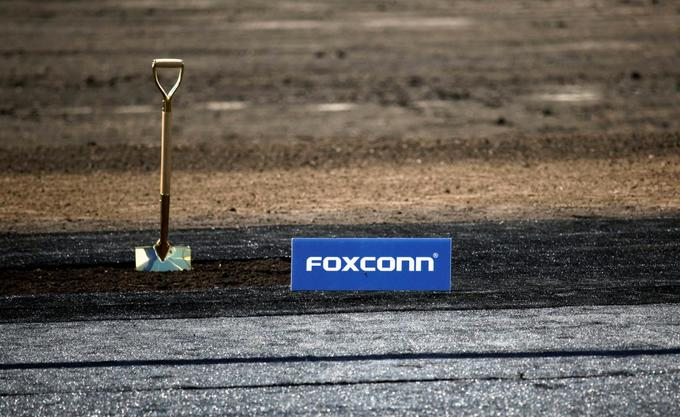 A shovel and FoxConn logo are seen before the arrival of U.S. President Donald Trump as he participates in the Foxconn Technology Group groundbreaking ceremony for its LCD manufacturing campus, in Mount Pleasant, Wisconsin, U.S., June 28, 2018. Photo by Reuters/Darren Hauck
